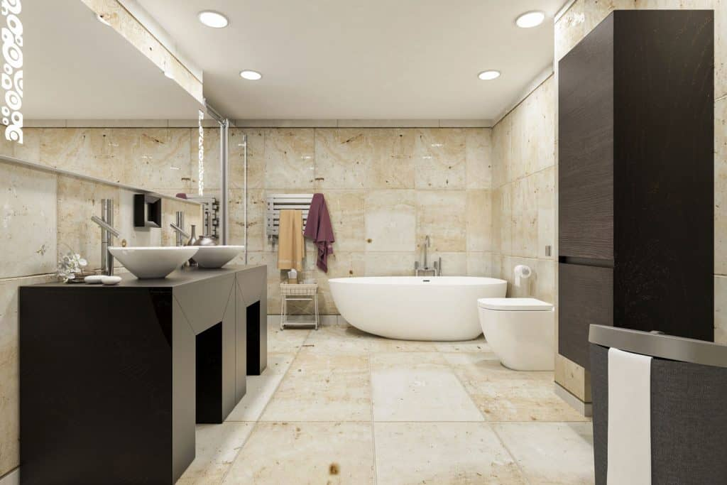 Interior of a modern contemporary bathroom with expensive tiles and a huge vanity mirror