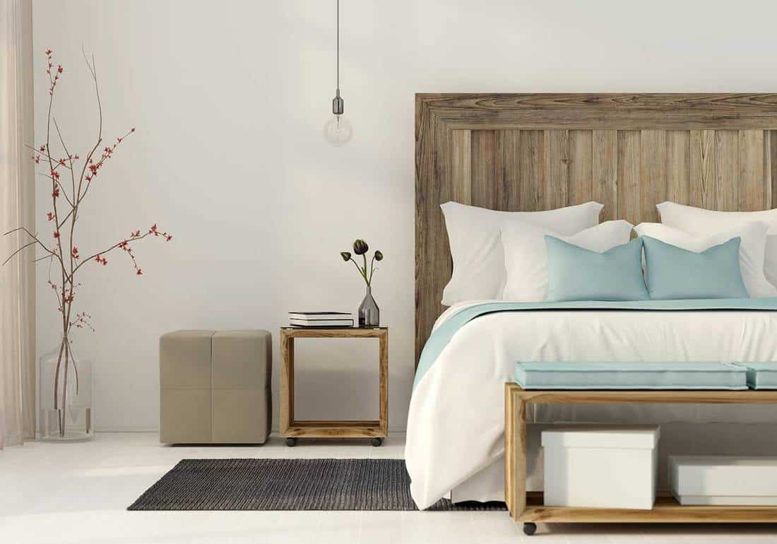Interior of the bedroom in a minimalist style with wooden furniture