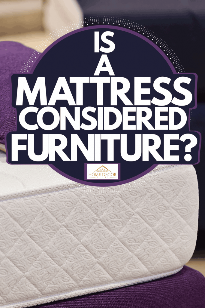 A comfortable and thick mattress with a purple colored pillow on top, Is A Mattress Considered Furniture?
