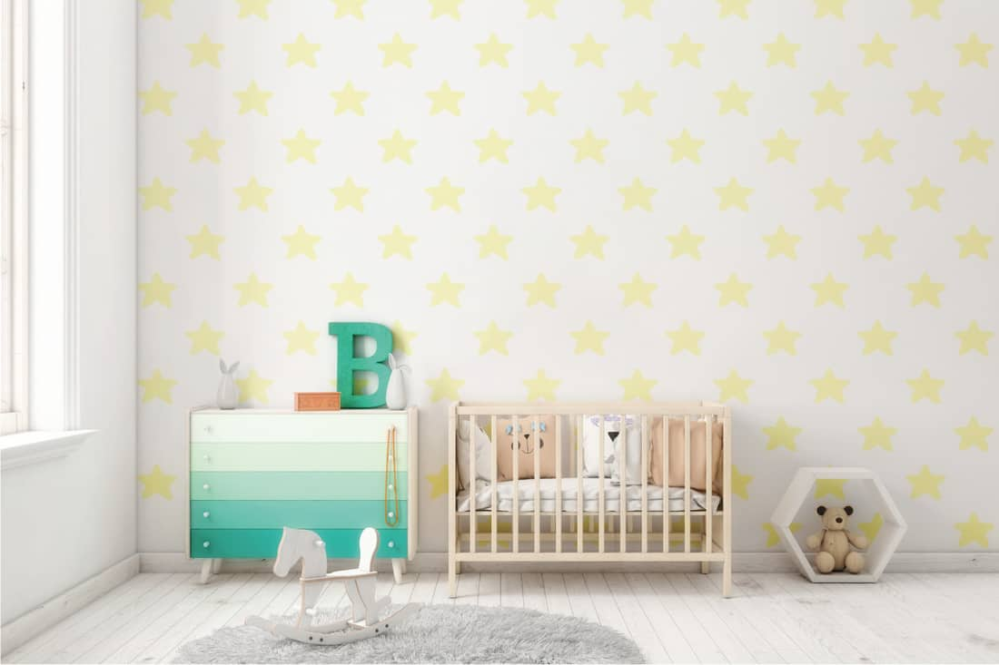 Kids room interior, with bed, lots of decoration, pillows, toys. Pastel colors. Daylight scene