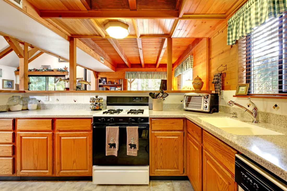 Kitchen interior in log cabin house with wood drop ceiling