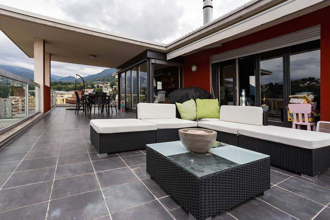 Large terrace furnished with outdoor furniture