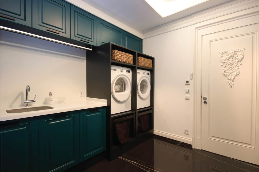 Laundry Room at the Modern Home with new orleans charm cabinets