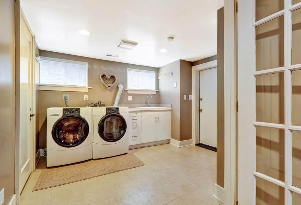 Laundry room interior with khaki or tan wall paint