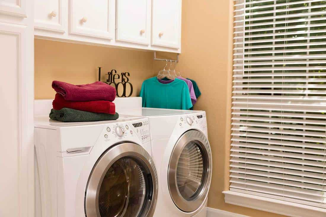 Laundry room with towels folded and clothes hung to dry