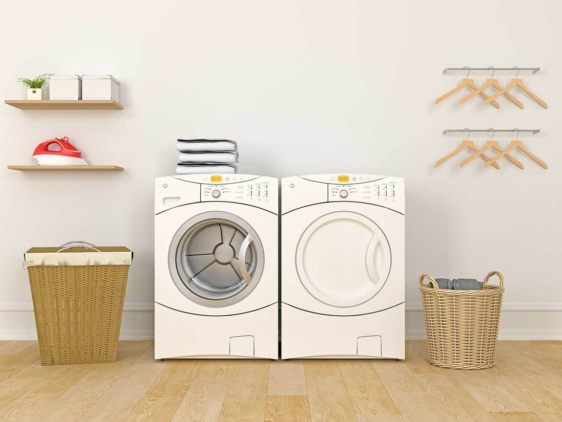 Laundry room with washer, dryer and wicker baskets