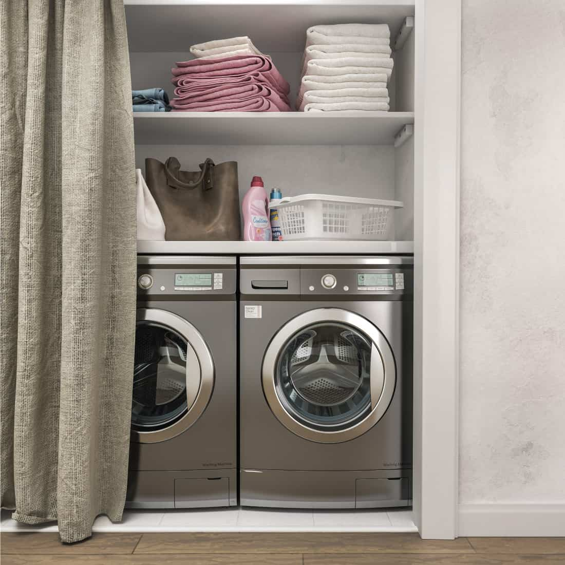 Laundry room with wood floor, washing machine at closet,white wall, shelving, clothes and curtains