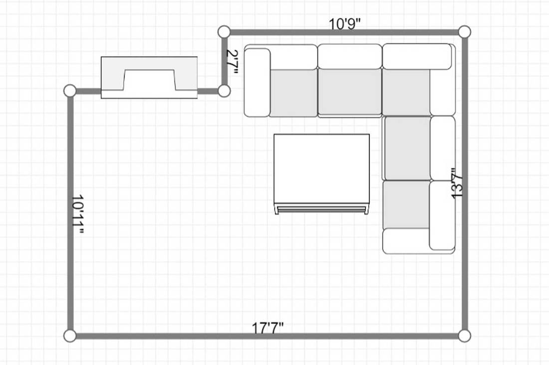 Layout of a large corner gray sofa in living room with white wall, fireplace and coffee table