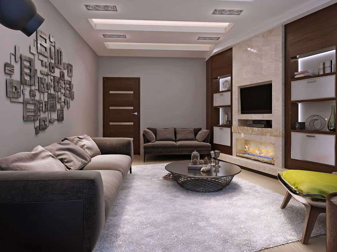 Living room in a modern style with cozy sofa set and carpet on floor