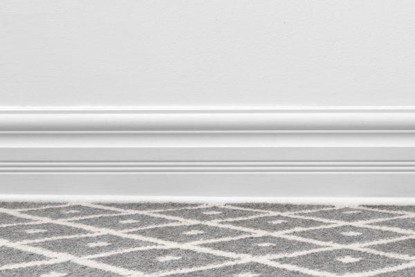 Should Carpet Go Under Baseboard?