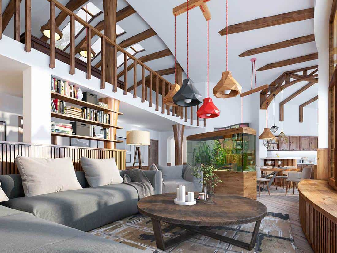 Loft style modern living room with aquarium and stylized shelving for books