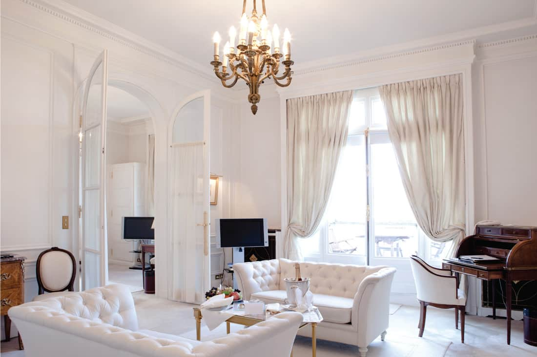 Luxurious living room of a hotel suite. classic white living room