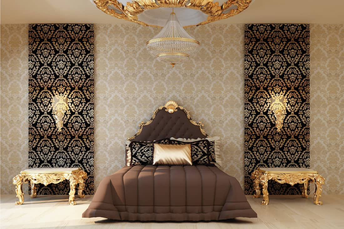 Luxury bedroom with golden furniture in royal interior. fit for royal wallpaper
