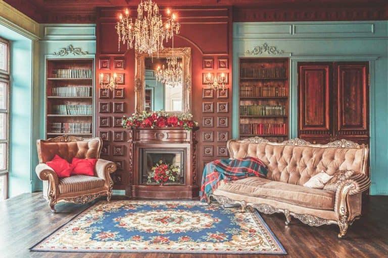 Luxury hacienda style interior living room with bookshelf, books, arm chair, sofa and fireplace, 21 Hacienda Style Living Room Ideas