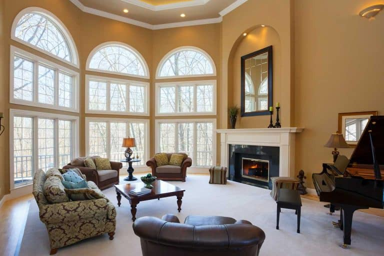 Luxury living room with fireplace, vaulted ceiling and grand piano, 15 Awesome High Ceiling Living Room Ideas