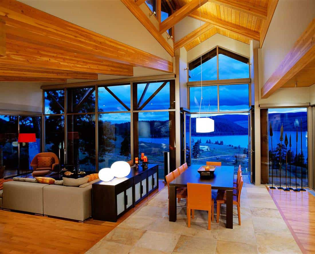 Luxury property home interior living room with large mirror windows