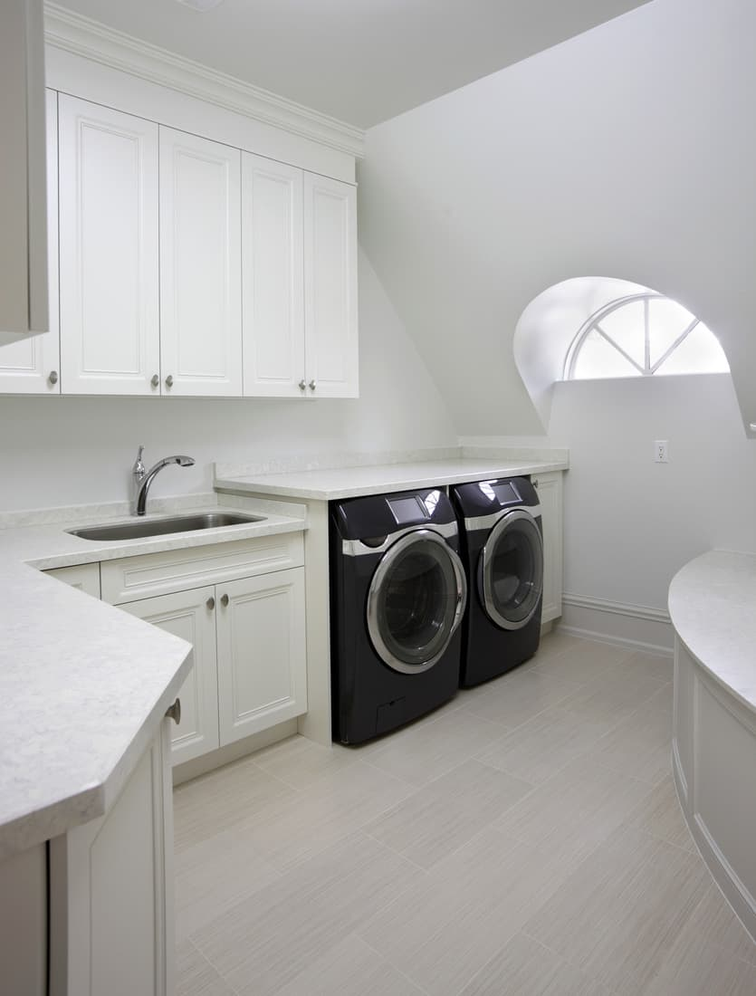 Modern Laundry room inside brand new North American residence with bright and white wall paint