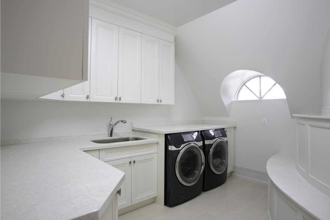 Modern Laundry room. White Laundry Room, Smoke Grey Washer And Dryer