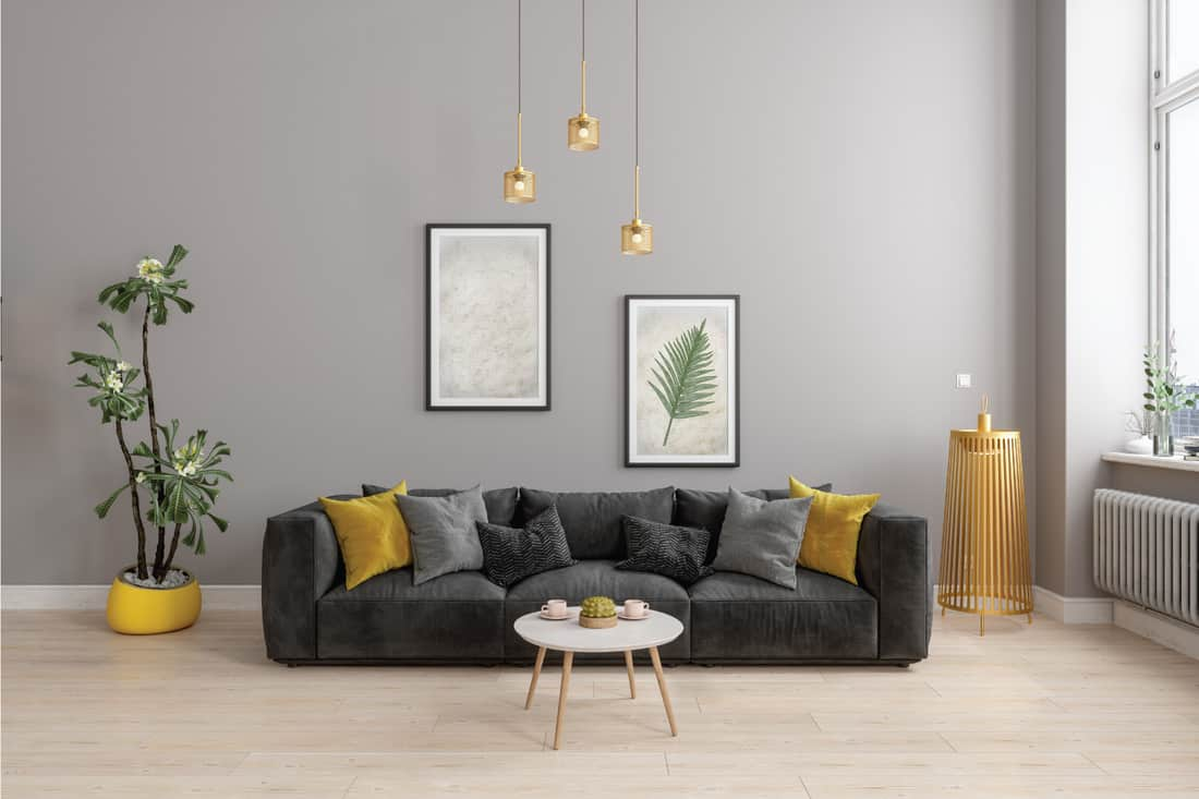 Modern Living Room With Yellow Sconce, Gray Sofa And Yellow Pillows, gray frame