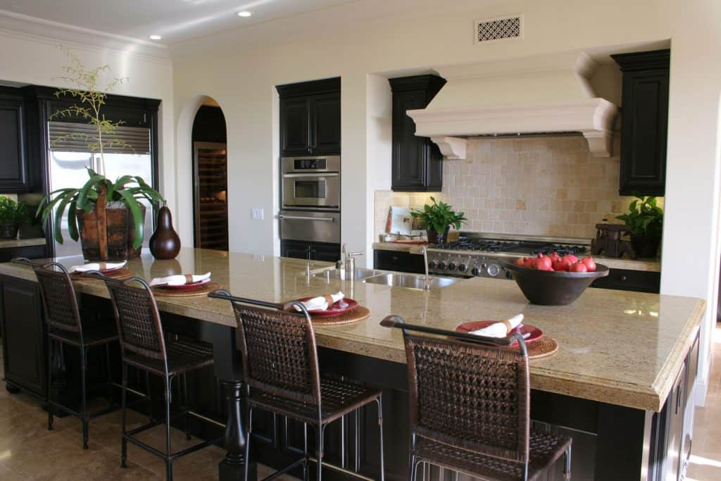 Modern Mediterranean themed dining room with rattan chairs on the breakfast bar