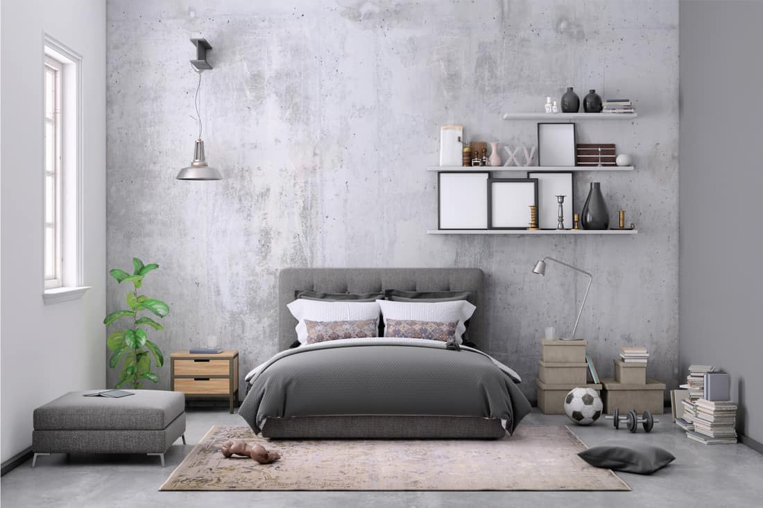 Modern bedroom interior, with bed, night tables, lamps, and many details around. Many books and decoration, wall is rich in texture