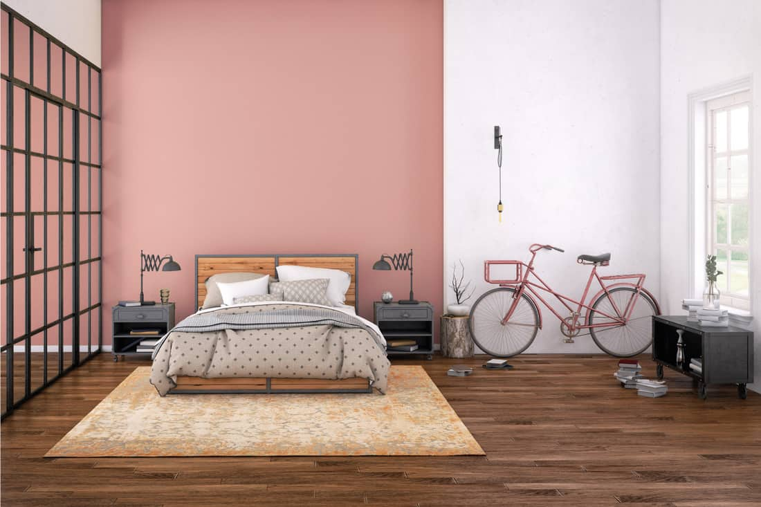 Modern bedroom interior, with bed, night tables, lamps, and many details around. soft blush wallpaper