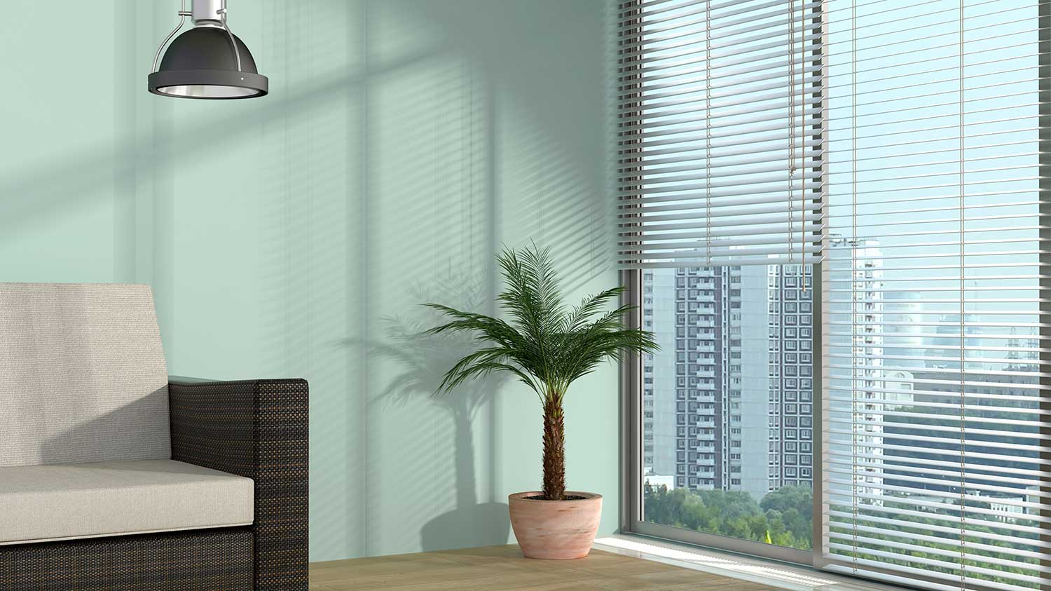 Modern interior room with potted palm tree and view of the city on glass window
