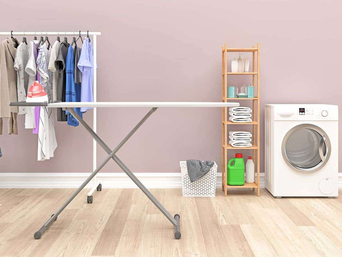 Modern laundry room with washing machine and cleaning supplies