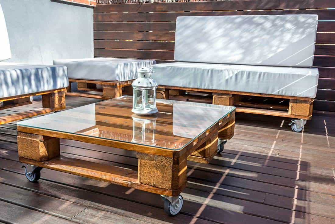Modern recycling furniture in a terrace set on a wooden deck