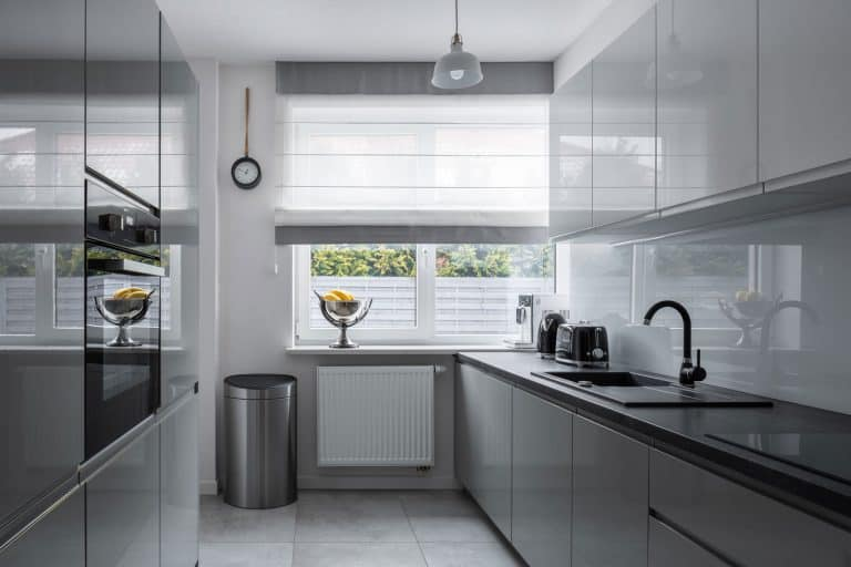 Narrow kitchen with window and modern, gray furniture, How To Hang Curtains On A Narrow Window