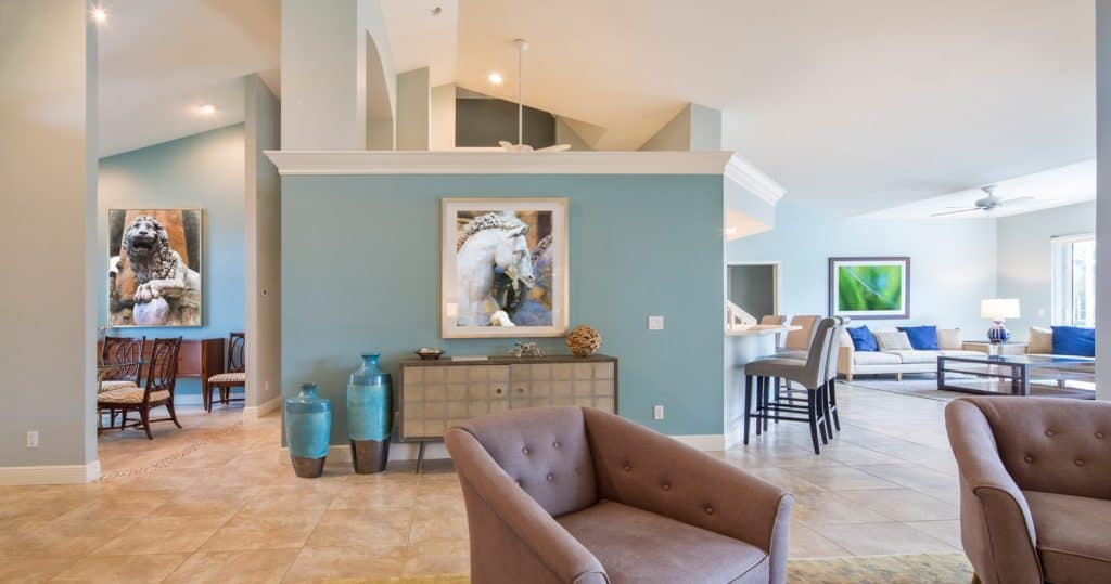 Open living space featuring living room, family room and dining room in this home.