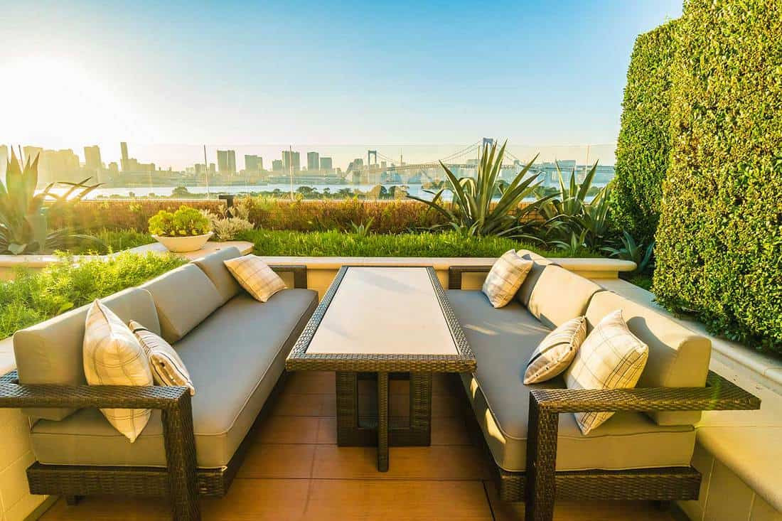 Outdoor patio with table and chair around rainbow bridge