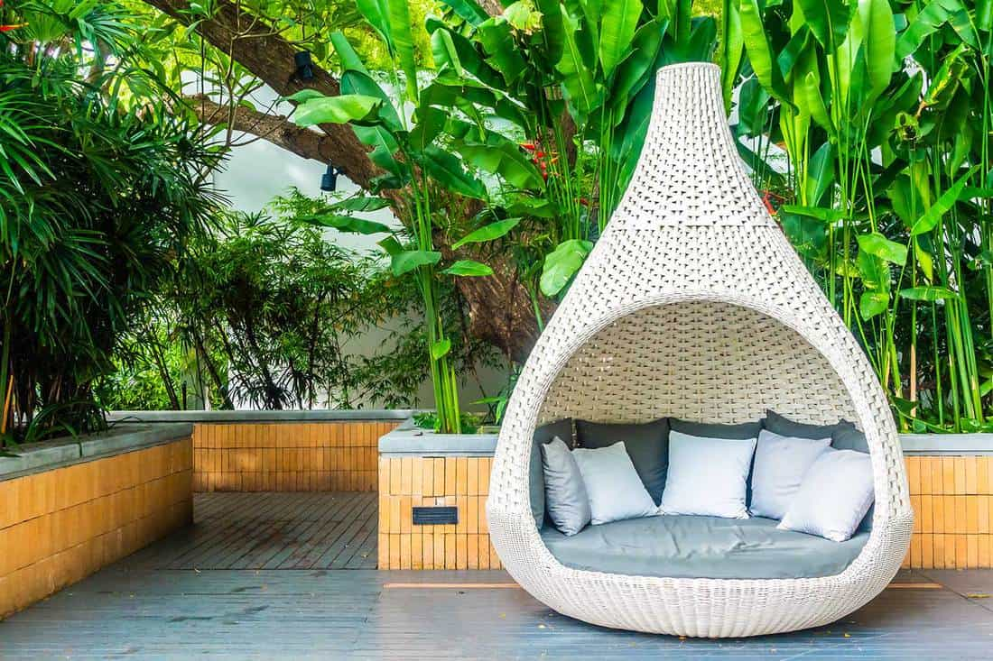 Patio with comfortable pillow on wicker sofa with tropical and nature view