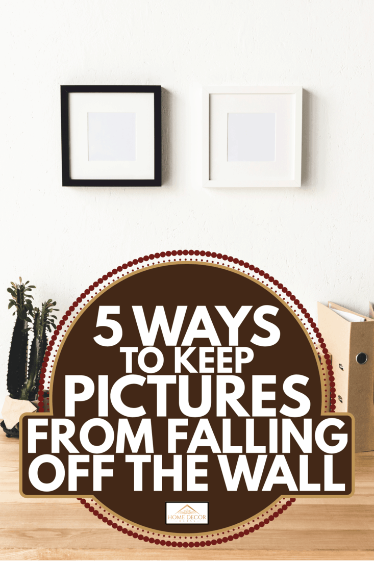 Photo frames hanging on wall in room. 5 Ways To Keep Pictures From Falling Off The Wall