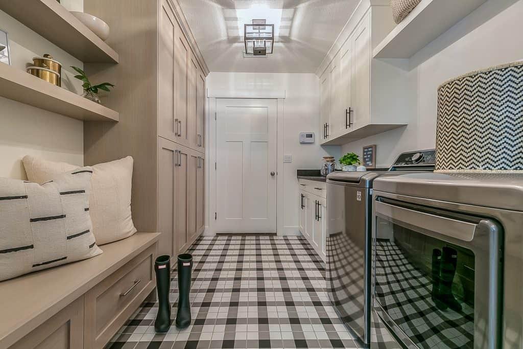 Buffalo plaid tile bathroom, Rain boots and gingham decorated flooring in new custom home