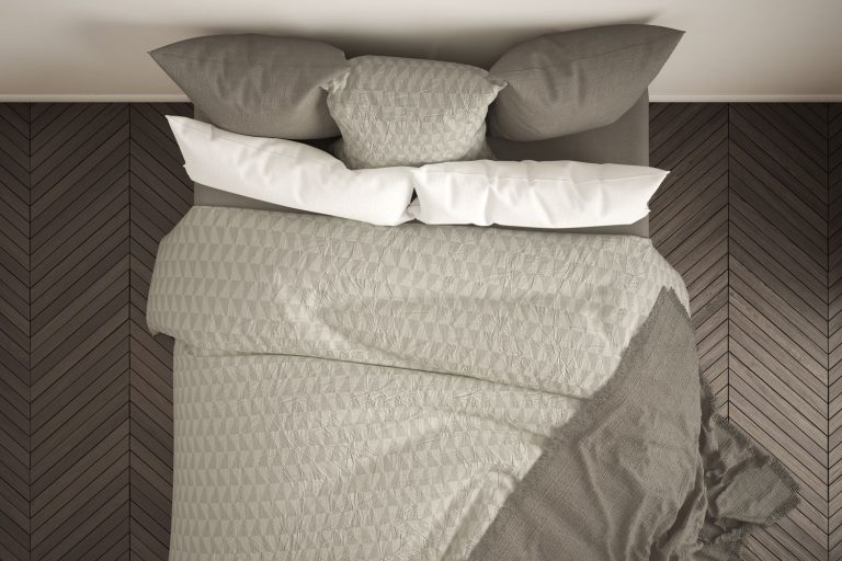 Scandinavian classic bedroom, top view, closeup on double white and cream bed, parquet floor, contemporary modern interior design with pillow top mattress, Can You Flip A Pillow Top Mattress?