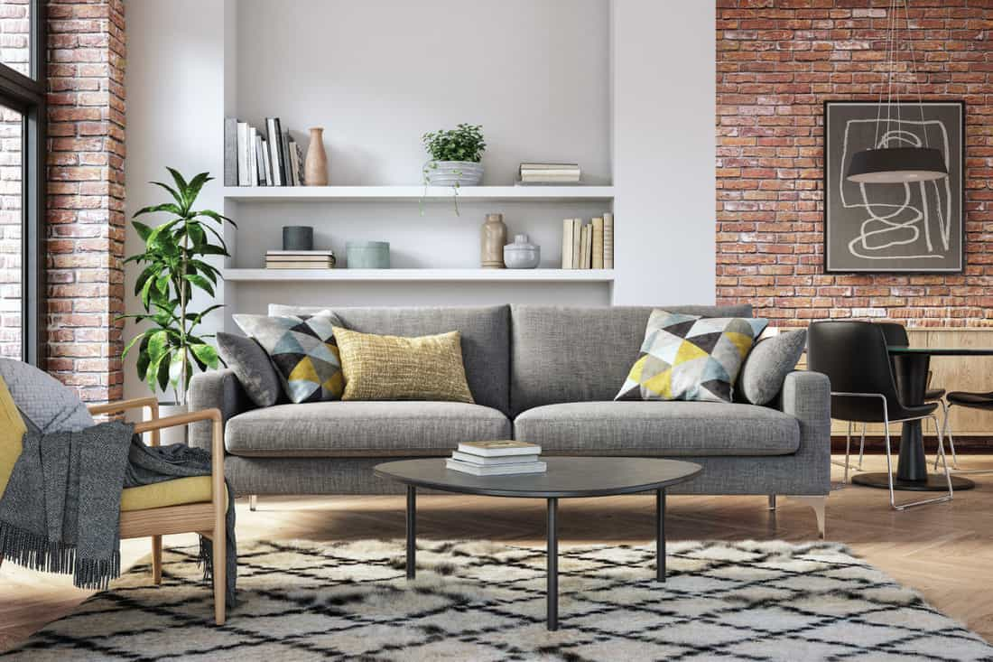 Scandinavian interior design living room with gray and yellow colored furniture and wooden elements, recessed shelves
