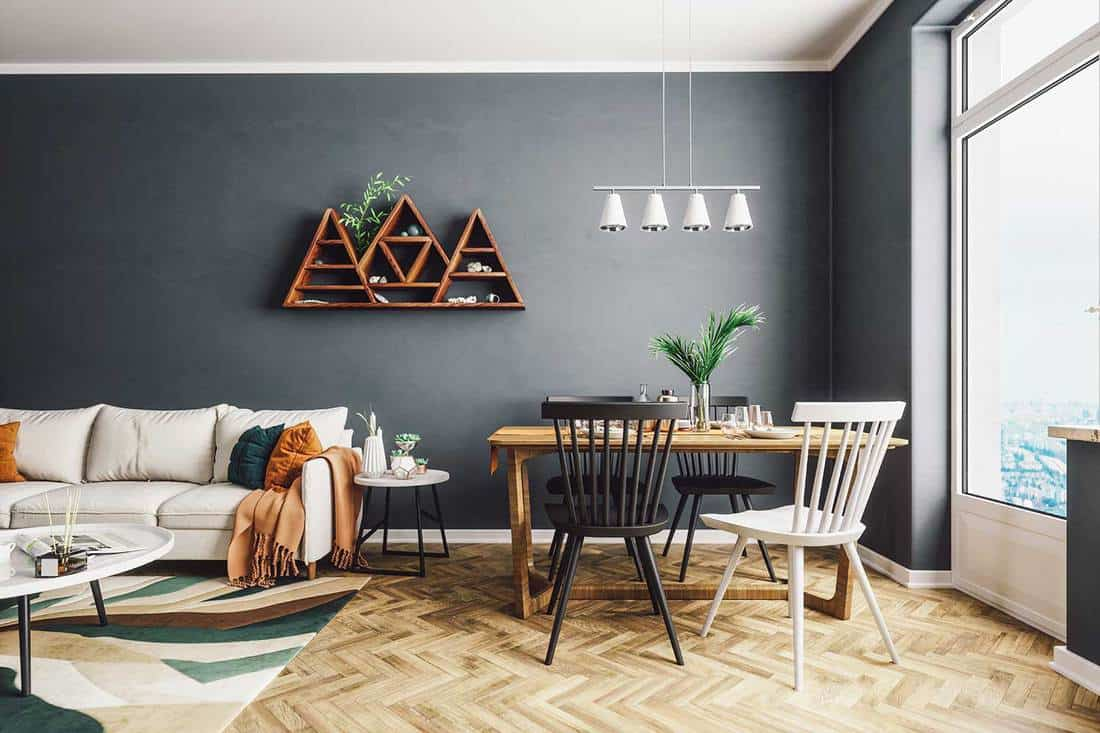 Scandinavian style condo living and dining room with parquet floor and city overview on glass window