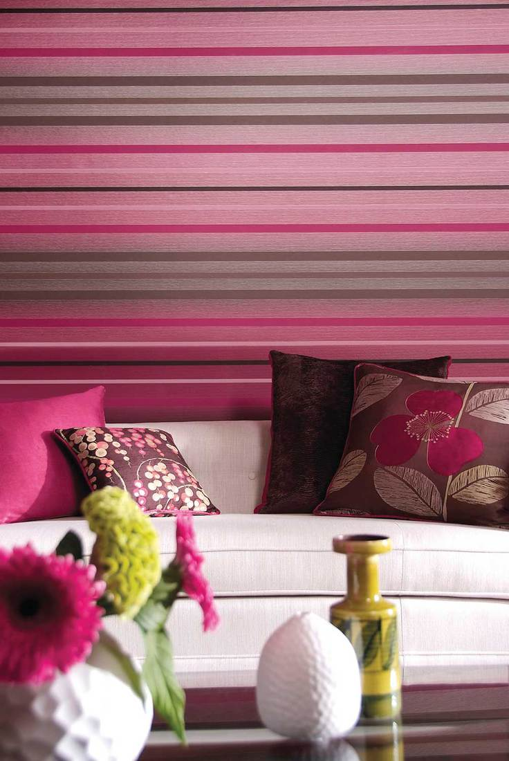Shot of cozy couch with horizontal stripes wallpaper wall