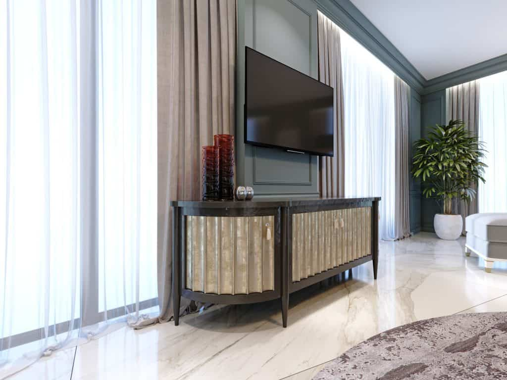 Sideboard with a TV against the wall in a modern classic style