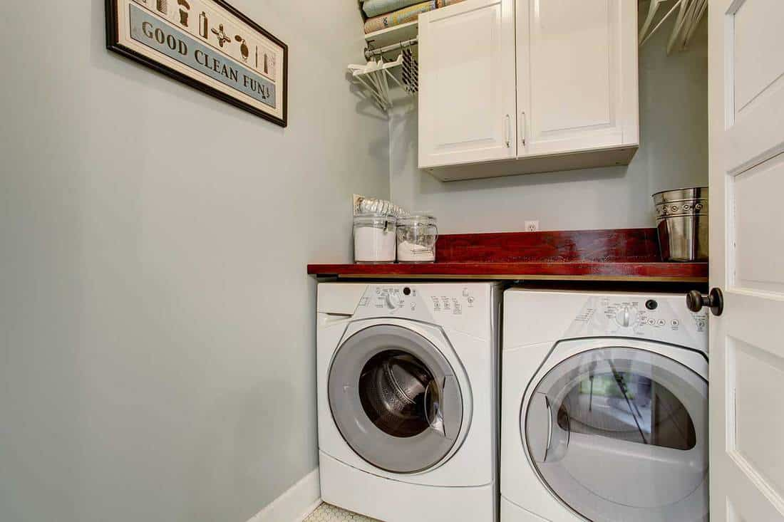 Small laundry room with door and wash dryer set