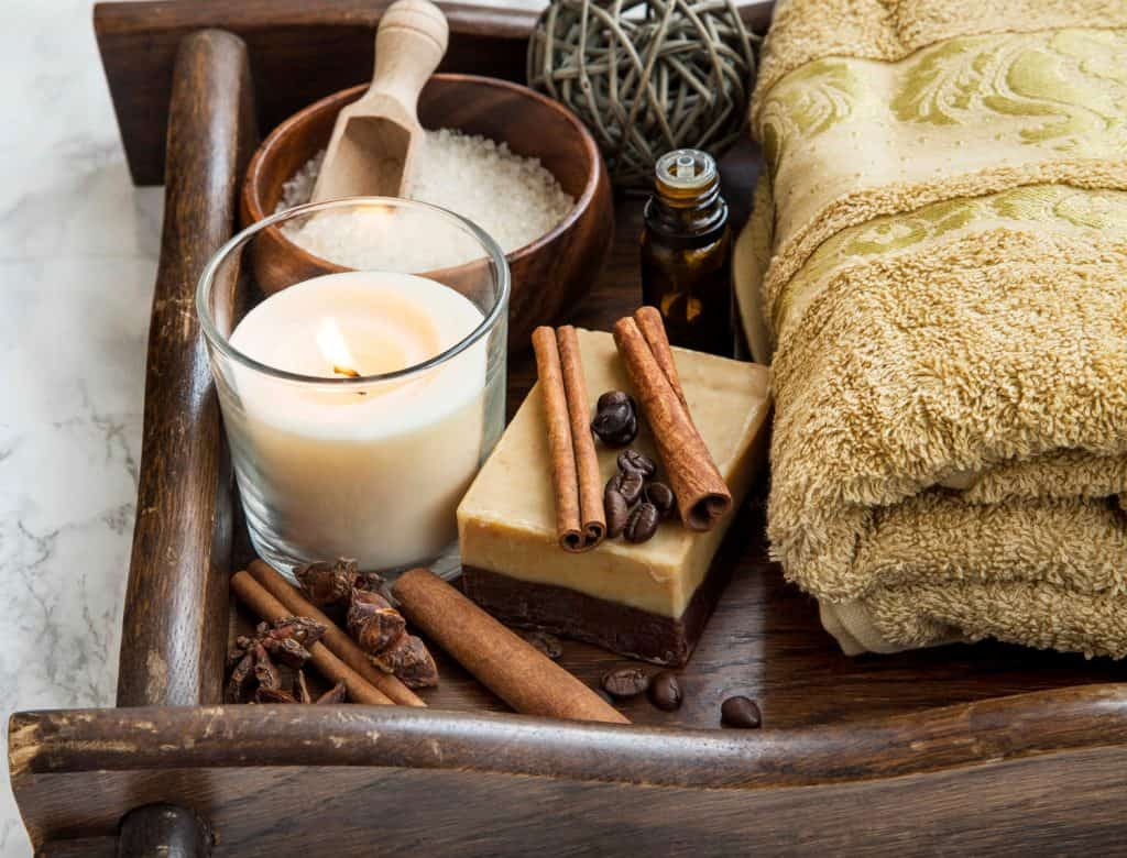 Spa setting with coffee and cinnamon soap, towel candle and sea salt