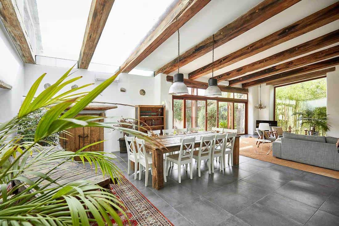Spacious dining area in a bright refurbish Mediterranean farmhouse