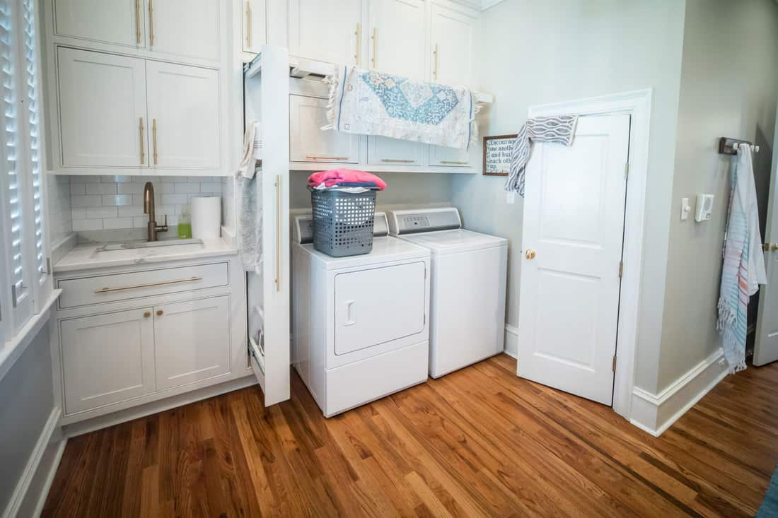 Spacious laundry room with white appliances