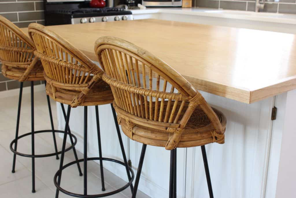 Three rattan chairs with metal standing frame on the breakfast bar