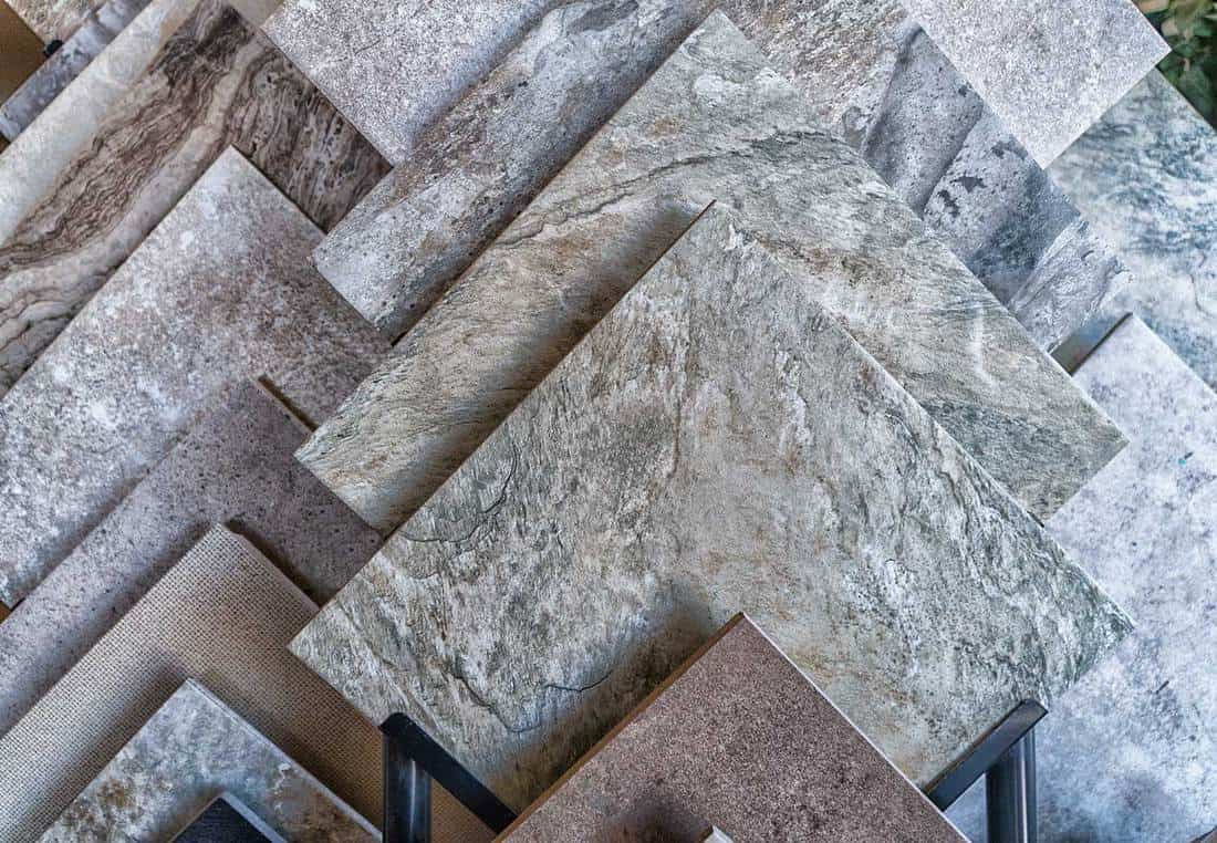 Tile flooring samples selection in rack in retail store
