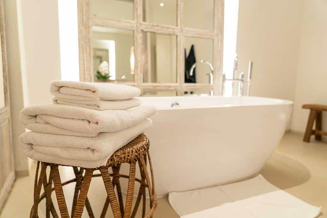 Towel with bathtub in luxury bathroom