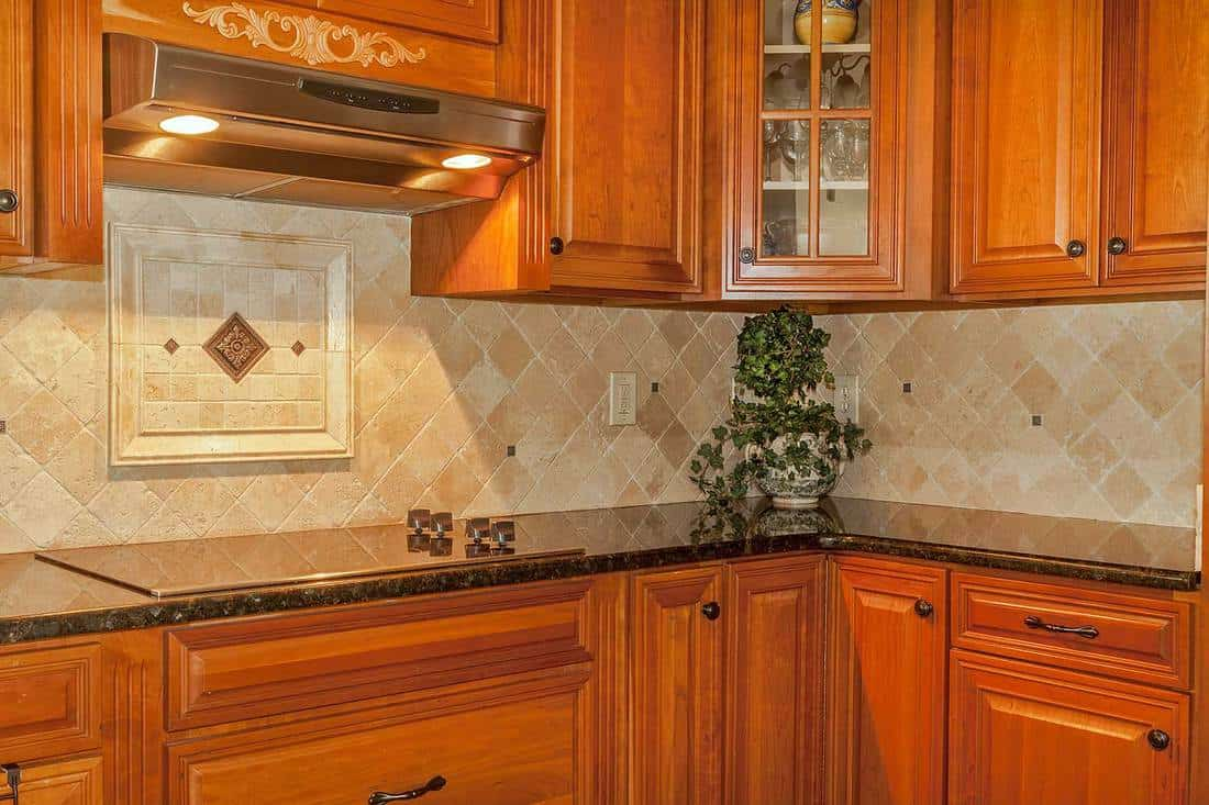 Traditional kitchen with stone back splash and granite counter top