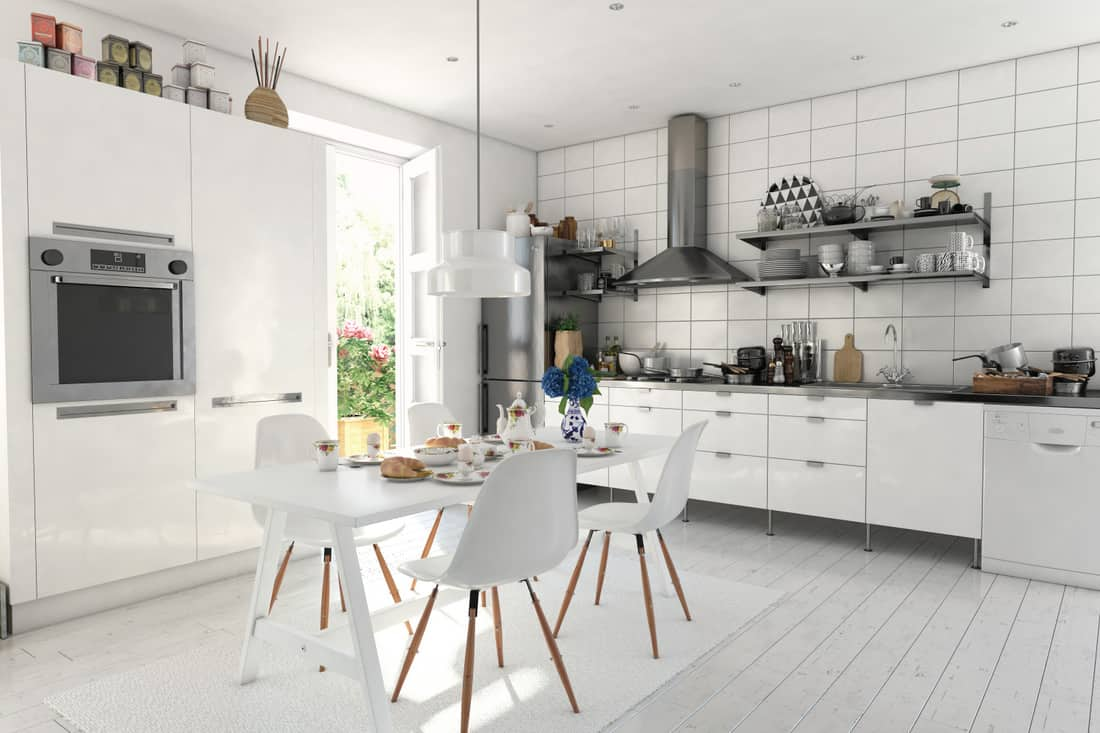 Typical Scandinavian style kitchen interior design, white flooring, sleek stainless steel countertops, black and white essentials. white a culinary delight