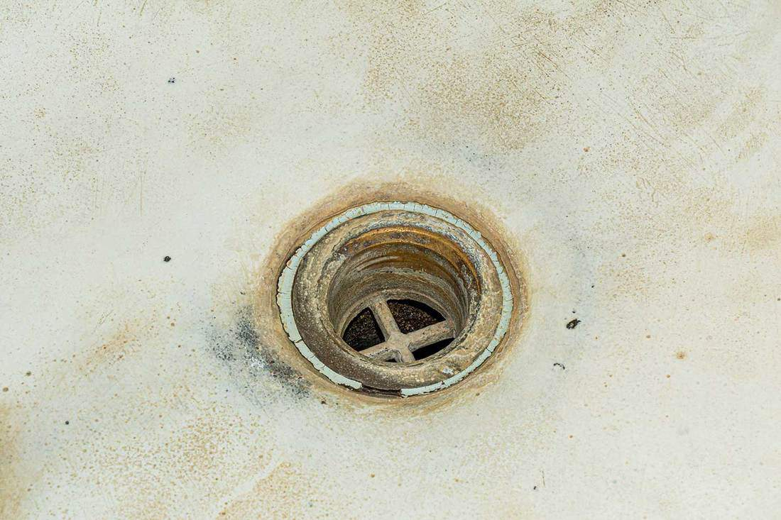 Uncleaned drain hole in the bathroom